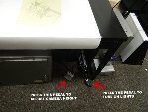 Pedals used to turn lights on, and raise and lower camera arm.
