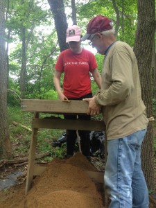 Two field school students screening for artifacts at the SERC site.