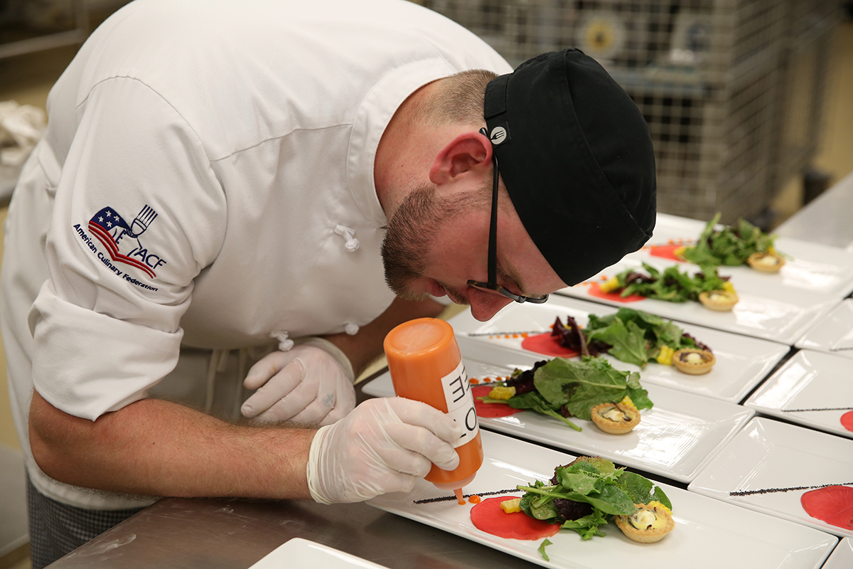 Sam Hart plating food