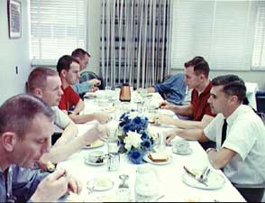 Rice's Curt Michel, third from left, dines on the traditional steak-and-egg breakfast with Neil Armstrong and others on the day Armstrong and David Scott blasted into orbit on Gemini 8. From lower left: Deke Slayton, the Manned Spacecraft Center's assistant director for flight crew operations; Armstrong; Michel; astronaut Walter Cunningham; astronaut office chief Alan Shepard; Scott; and astronaut Roger Chaffee.