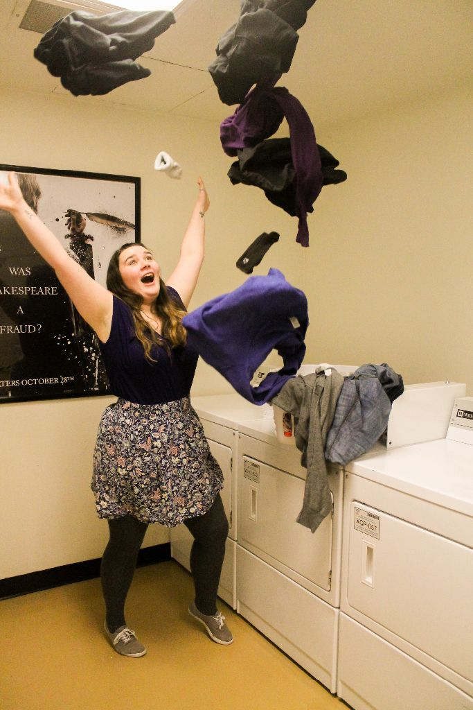 Sophomore Mary Marston, above, finds ways to release stress in the laundry room. Finding working CentreBucks machines, quarters, and open machines can be unneccessarily stressful.