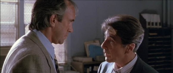 Ricky Roma (Al Pacino) discusses a land deal with James Lingk (Jonathan Pryce)