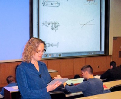 Christine Masters makes notations on her iPad, which is projected to the class using Doceri.