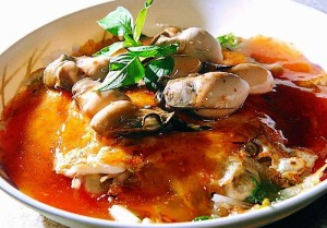Carefully garnished with oysters, this o-ah-jian (oyster omelet)  is too aesthetically pleasing to the eye