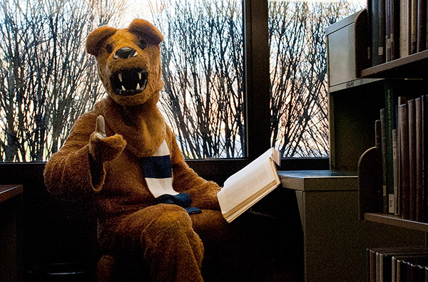 Nittany Lion mascot gesturing at viewer.