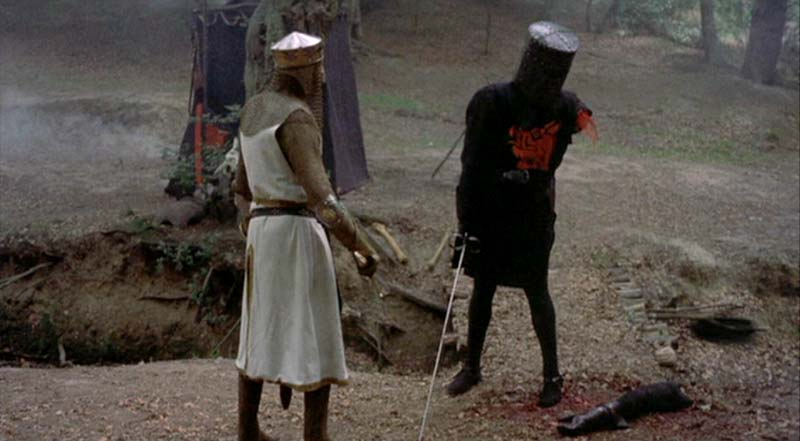 """""""The Black Knight always triumphs!"""" says the limbless fighter as he attempts to defeat King Arthur by kicking him."""