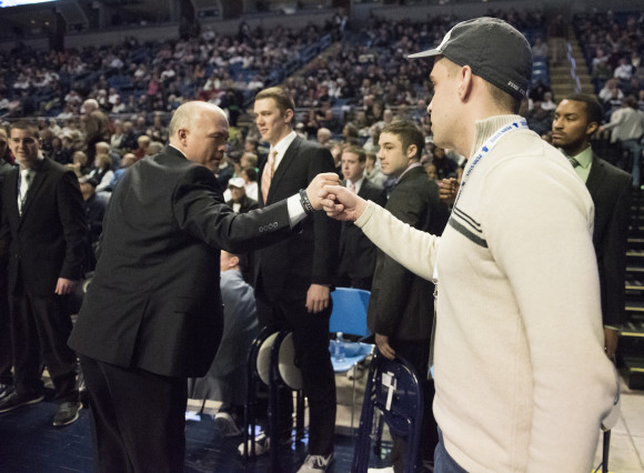 Charlie Kuhns fist-bumps Pat Chambers