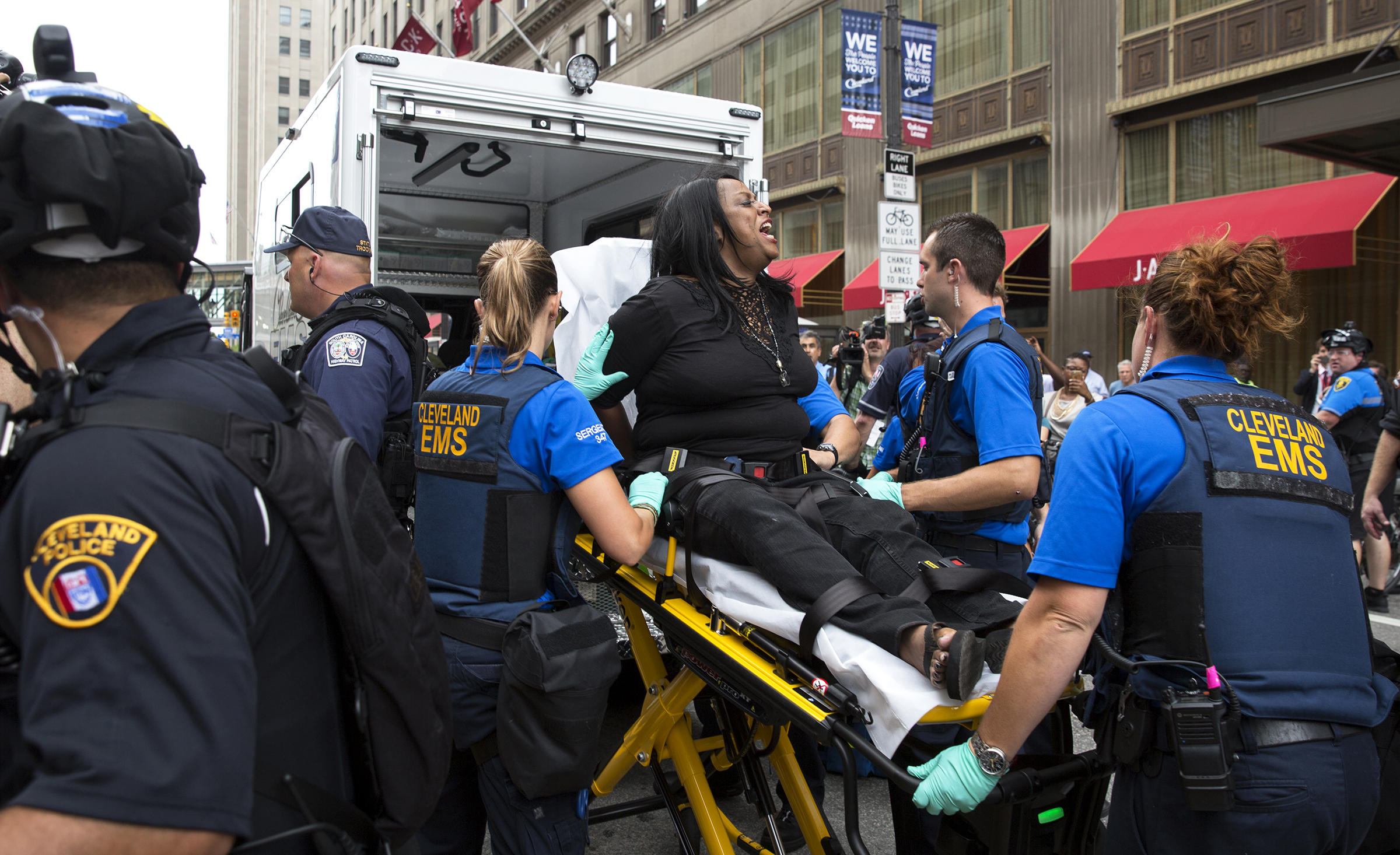 Activist Kathy Wray Coleman, of Cleveland, who was handcuffed by police during a protest at the Republican National Convention on Monday, is transported to an ambulance after she complained of chest pains. Coleman is a leader of the Imperial Women's Coalition. (Photo by Antonella Crescimbeni/Penn State College of Communications)