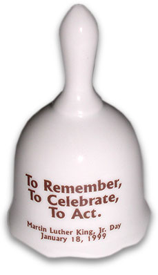 """1999 Bell with text """"To Remember, To Celebrate, To Act."""""""