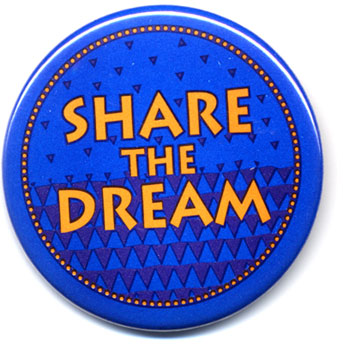 """Button: Theme: """"Share the Dream"""" Designer: Aaron Singleton, Inspired by the patterns of Kente Cloth from Chana."""