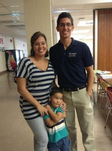 Adriyel Nieves, SHPE Penn State president and electrical engineering major, spending time with a family at Noche de Ciencias