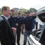 Charles Whiteman, dean of the Penn State Smeal College of Business, discusses the EcoCAR competition with members of Penn State's Advanced Vehicle Team.