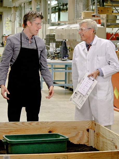 "National Geographic show host David Rees, left, dicusses a shovel experiment with Andris Frievalds, professor of industrial engineering. In the ""Going Deep With David Rees"" segment, the two measured the workload, which is the pounds of dirt Rees was able to move with each shovel compared to his physical exertion, oxygen and heart rate. (Photo credit: National Geographic)"