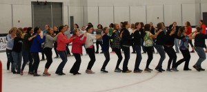 WEPO broomball quickly devolves into a line dance at Pegula Ice Arena.