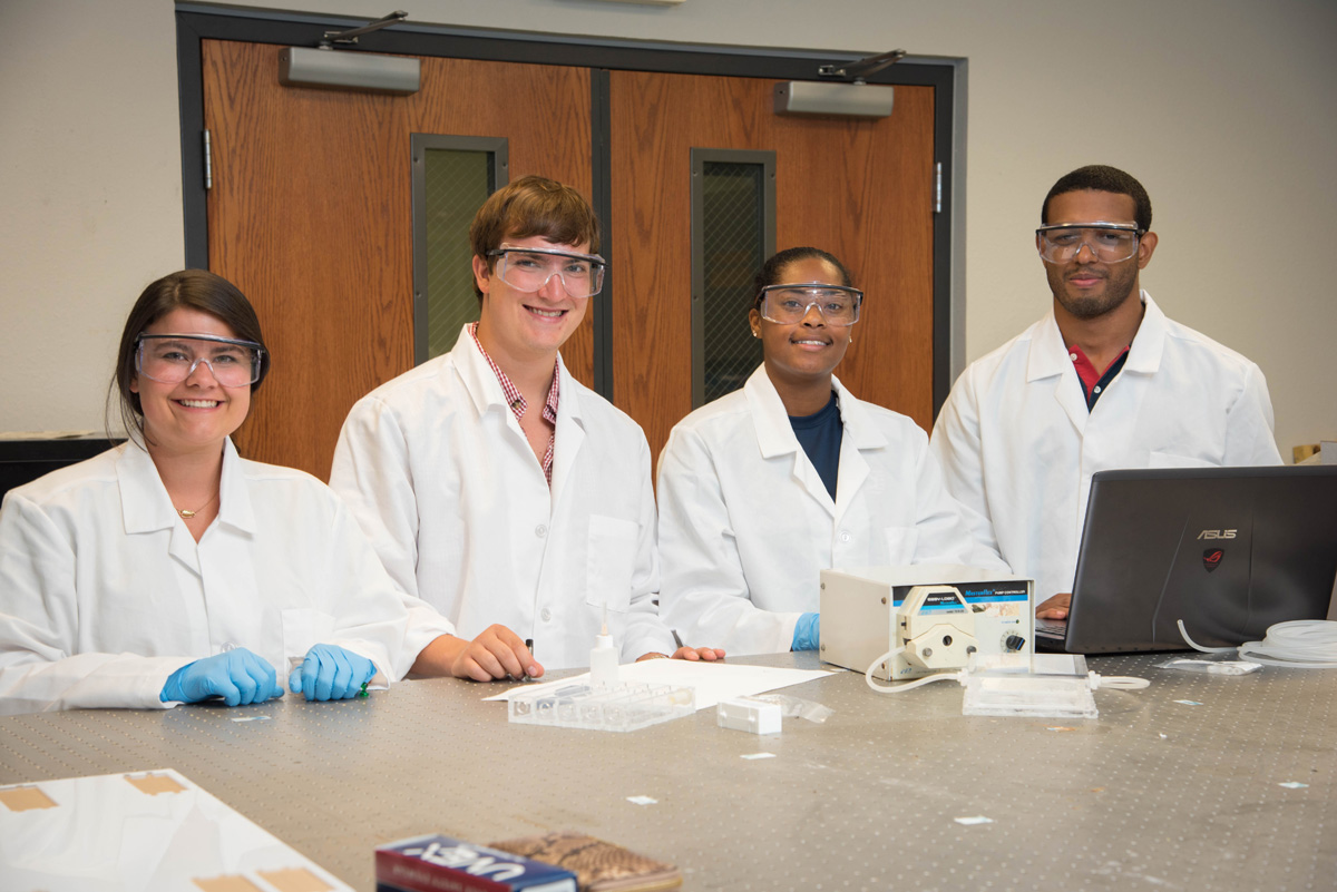 Anna Brickell, Curran Henson, Dymonn Johnson and Vinicius Sardinha, all of whom worked together to research heart attacked this summer.