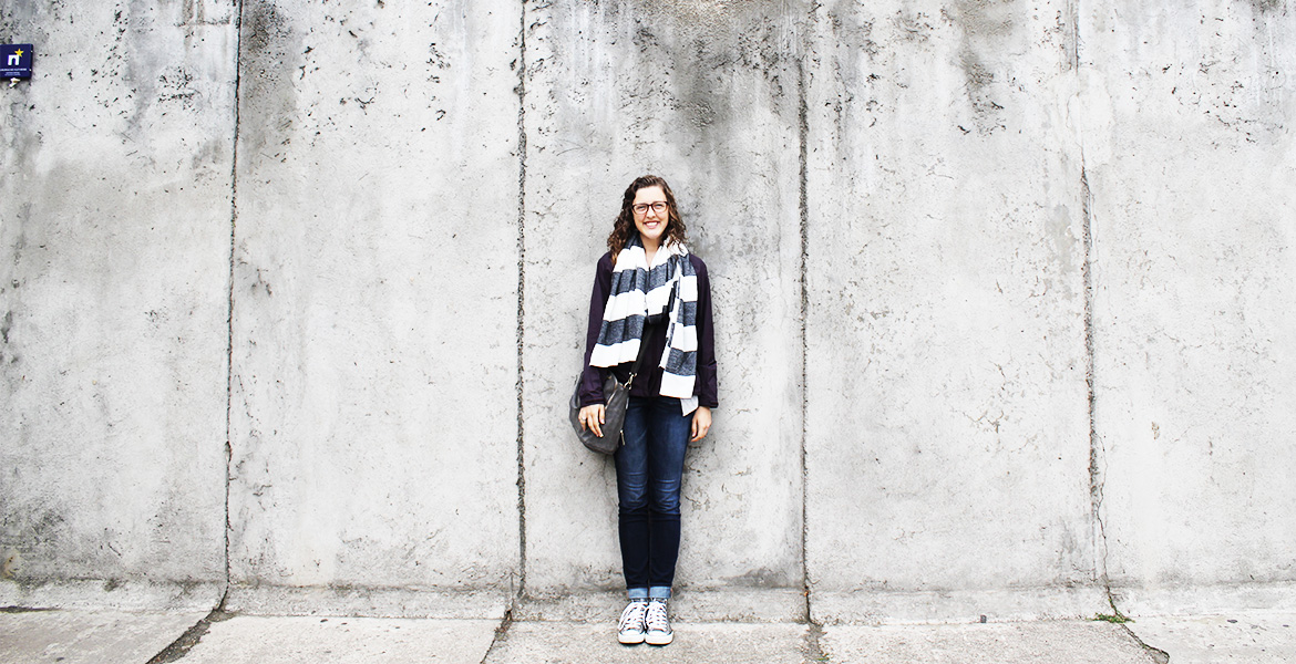 Feekin with part of the Berlin Wall during her study abroad trip to Germany.